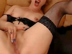 Blonde mature toys her ass on webcam