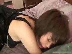 Alluring Asian girl in sexy black lingerie has a passion fo