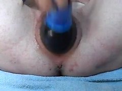 Shaved vagina drilled with a dildo that was fat