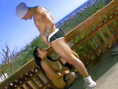 Busty brunette gets sex on balcony
