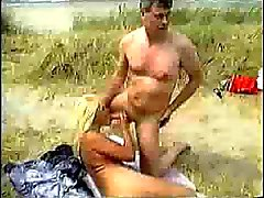 Wild sex among the dunes of a beach