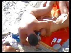 VOYEUR ON THE BEACH 17 redhead teen and her friend fucked