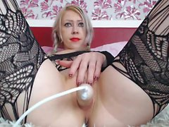 Sensuous blonde in black lingerie makes herself cum hard with a dildo
