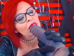 Mature Redhead With Glasses Sucking Dildo