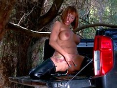 Tattooed slut in leather boots gets naughty in the back of a truck