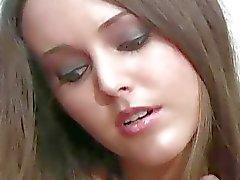 Longlegged girl in hose boasts of goodies