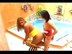 Burning Tgirls poolside twosome