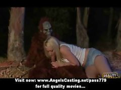 Wonderful super sexy blonde slut with big tits fucking with a gorilla in nature