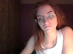 Nerdy red-haired chick gets bored in front of the computer