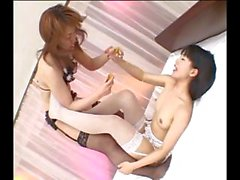 Two Japanese girls kiss, eat pussy and toy pussy with a dildo