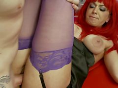 Horny redhead slut Mai Bailly sucks cock two at a time