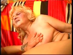 Old bitch fucks young slut's hairy pussy with strap-on