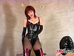 Japanese Slut Wearing Latex With A SLave