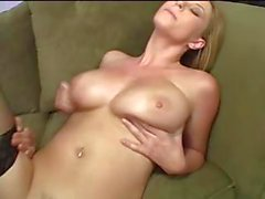 Busty blonde in stockings gets a big cock to suck and get fucked