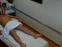 Horny asian masseuse sucks and tugs her client