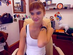 Skinny little redhead is on her webcam and does a slow stri