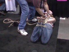 Bondage demo on barefoot girl