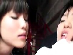 Alluring Japanese girls kiss each other and share hot lesbi