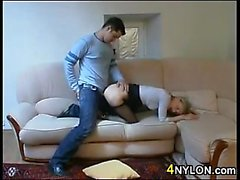 Blonde Smoker In Nylons Gives A Foot Job