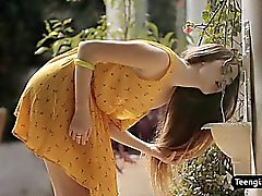 Natural teen beauty plays with her shaved pussy outdoor
