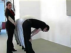 Strict Mistress punishes 3 slaves