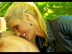 Mistress teases slaves outdoors