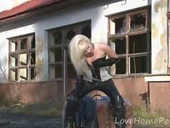 Beautiful blonde strips in an abandoned village
