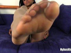 Ebony chick stretching feet and stocking