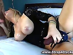 Strapon domina sucks on cock