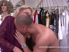 Mature blonde lady fucked by a manikin in a clothing shop