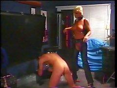 Blonde mistress spanks boy