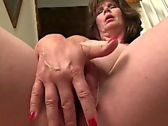 Horny Mature Jade in evening dress masturbates with toys