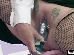 Hottie in fishnets gets strapon fucked