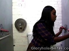 Busty black babe strokes 3 big fat gloryhole cocks