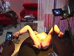 Porn starlet stripping and masturbating at erotic fair