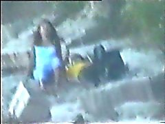 teen couple caught on the beach