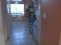 Taped up girl hops around house