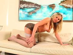 Blonde girl on white leather bedstead