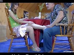 Lewd chick using her pantyhosed feet