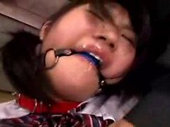 Big tit Asian hottie is tied and gagged and groped by two m