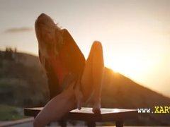 Blonde woman Francesca during sunset