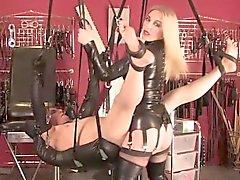 Strapon wielding mistress dominates sub