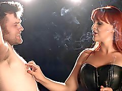 Mistress Amber Leigh smokes her slave