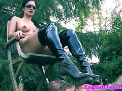 Mistress pissing on sub outdoors in the mud