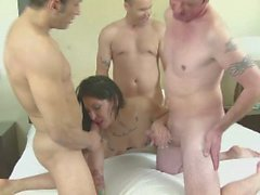 Group of studs drill a brunette in a gangbang
