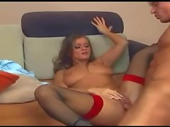 Blonde fucked on a couch in fishnet stockings