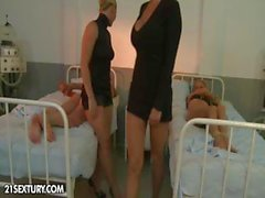 Two babes in the hospital take care of one of the patients in bed