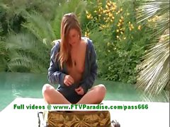 Hayley awesome brunette babe posing outdoor and playing with pussy