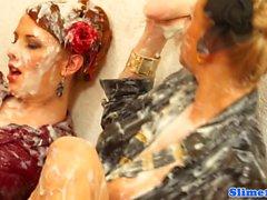 Lesbian Genny drenched in bukkake